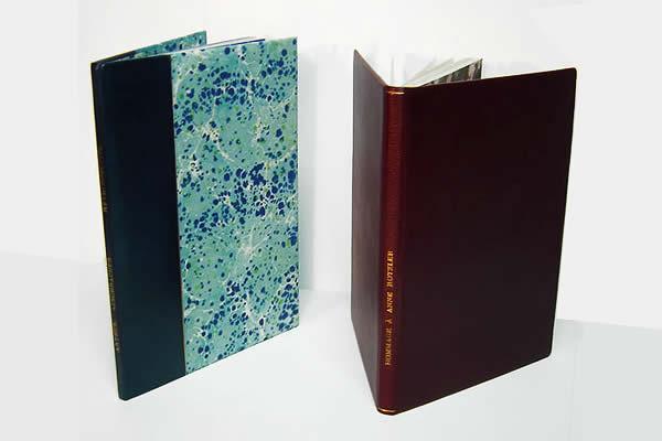 Deux livres reliés plein cuir et demi dos cuir